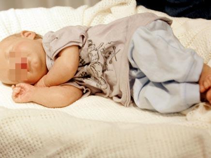 """תינוק נמצא מת בדירה בת""""א. ארכיון (צילום: רויטרס)"""
