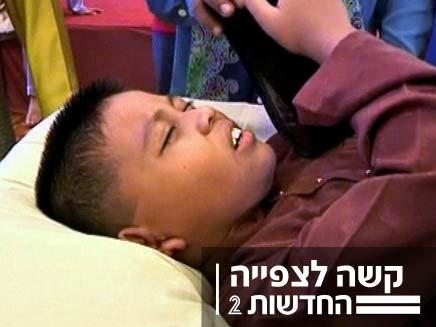 צעיר מוסלמי שעובר ברית מילה (צילום: חדשות 2)