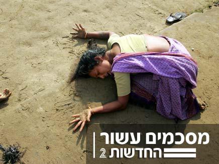 אשה מתאבלת לאחר הצונאמי (צילום: חדשות 2)