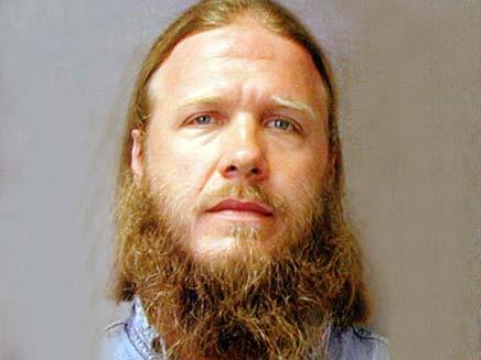מחבל בלונדיני עם עיניים כחולות בארגון אלקעידה (צילום: AP)