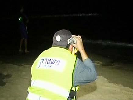 חיפושים אחרי הצוללן אתמול בלילה (צילום: חדשות 2)