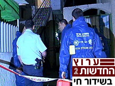 """זירת הרצח בת""""א (צילום: חדשות 2)"""