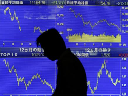 ההפסדים בשוק ההון חילחלו למאיון העליון. (צילום: רויטרס)