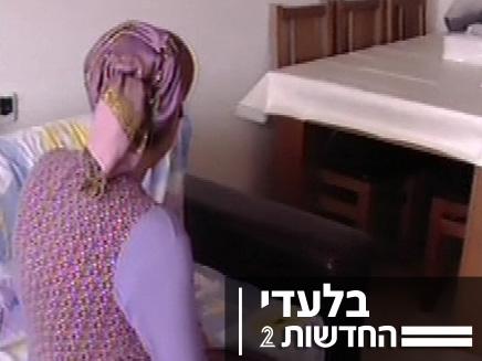 האם שהטיחה את תינוקה ברצפה (צילום: חדשות 2)