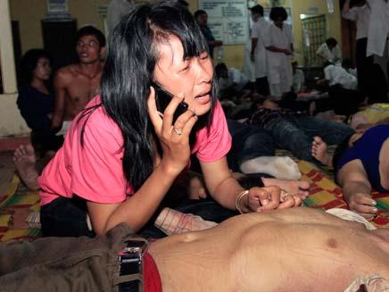 פצועים בקמבודיה, הערב (צילום: רויטרס)