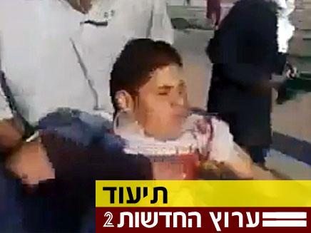 פצוע מירי בלוב (צילום: יוטיוב)