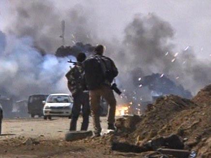 אנשי קדאפי טבחו במפגינים (צילום: חדשות 2)