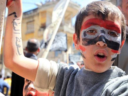 """""""אסד ביצע פשעים נגד האנושות"""" (צילום: RT)"""