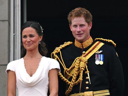 הנסיך הארי בחתונת אחיו, עם אחות הכלה (צילום: רויטרס)