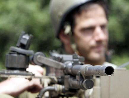 חייל עם נשק (צילום: Christopher Furlong, GettyImages IL)