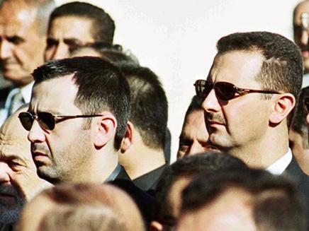 מאהר (משמאל) יחד עם אחיו בשאר (צילום: NEW YORK TIMES)