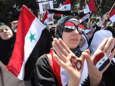 מפגינים בסוריה, ארכיון (צילום: רויטרס)