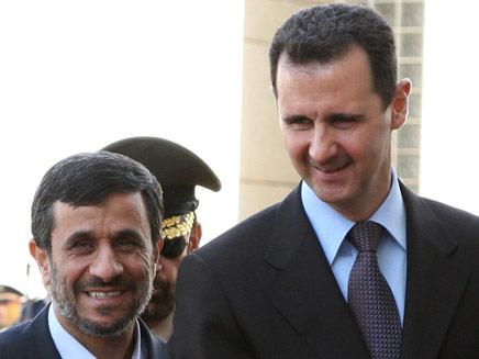 אסד ואחמדיניג'אד, ארכיון (צילום: רויטרס)