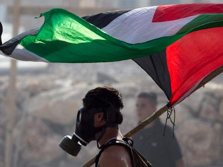 מזעם לתקווה: הפלסטינים מחכים להכרזת העצמאות (צילום: רויטרס)