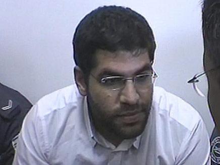 דניאל מעוז - רוצח הוריו בבית המשפט (צילום: חדשות 2)
