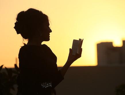 אוריין רייס עם סידור (צילום: אופיר פרקש)