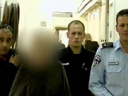 האם החשודה בהתעללות בילדיה. ארכיון (צילום: חדשות 2)