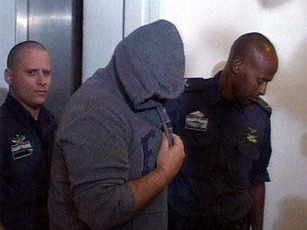 אבנר אברהם בעת מעצרו, ארכיון (צילום: חדשות 2)