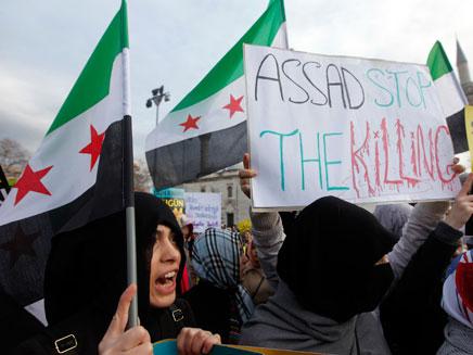 מחאה בעיר חומס הנצורה (צילום: רויטרס)
