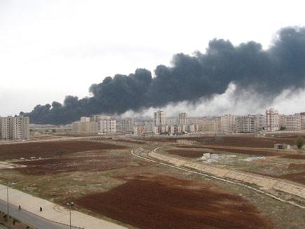 נמשכות ההפצצות הכבדות על חומס. ארכיון (צילום: רויטרס)