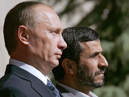 פוטין ואחמדינג'אד. ארכיון (צילום: רויטרס)