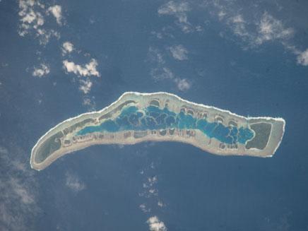 צילומים אחרונים של האי קיריבטי מעל פני הים (צילום: AP)