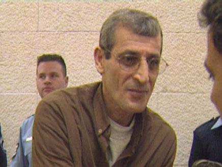 """אחיו של החשוד בהונאה, הרוצח הרצל אביטן ז""""ל (צילום: חדשות 2)"""