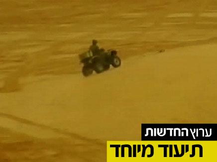 צפו: גנבים בין טנקים יורים (צילום: חדשות 2)
