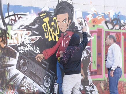 קיר הגרפיטי שצייר הלוחם באשדוד (צילום: גדי קבלו, באדיבות ידיעות אחרונות)