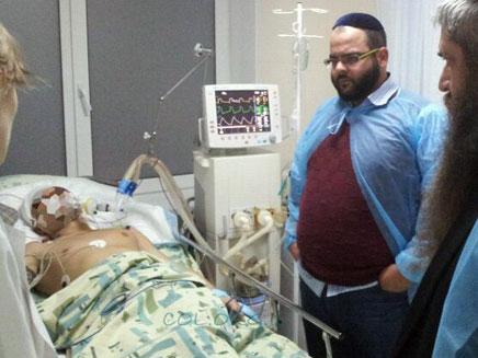 """אלכסנדר בבית החולים בקייב, אתמול (צילום: באדיבות חב""""ד און ליין)"""