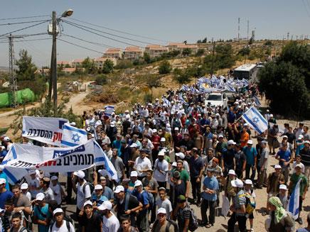 צעדת תמיכה בגבעת האולפנה , בית אל (צילום: רויטרס)
