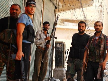 ממשיכים בלחימה. המורדים בסוריה (צילום: רויטרס)