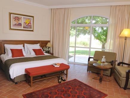 חדר השינה במלון פסטורל בכפר בלום
