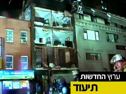 צפו בקריסת חזית הבניין בניו יורק (צילום: CNN)