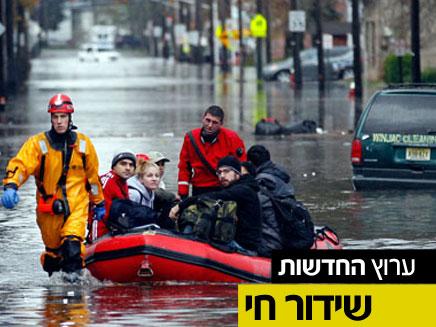 חילוץ ברחובות ניו יורק (צילום: רויטרס, AP)