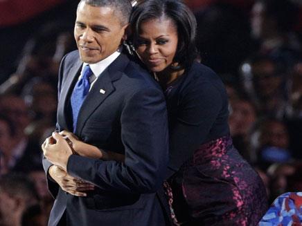 אובמה עם אישתו מישל, היום (צילום: רויטרס)