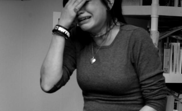 קלי מיטשל - בוכה (צילום: מתוך הבלוג dailyiowan)