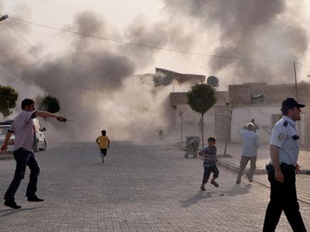 הפגזה בסוריה (צילום: AP)