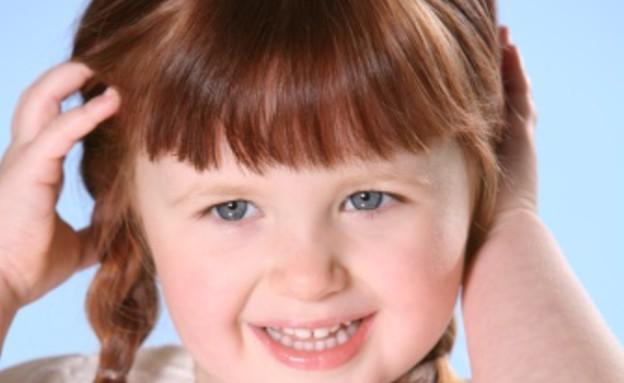 ילדה מחייכת (צילום: אימג'בנק / Thinkstock)