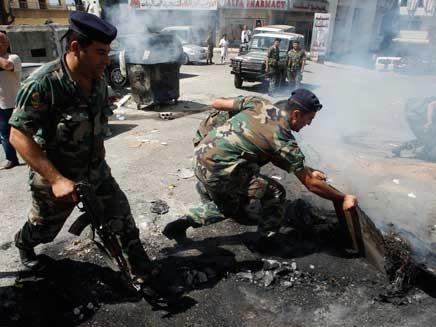 כוחות אסד צרים על המורדים בחומס