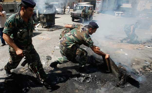 כוחות אסד צרים על המורדים בחומס (צילום: רויטרס)