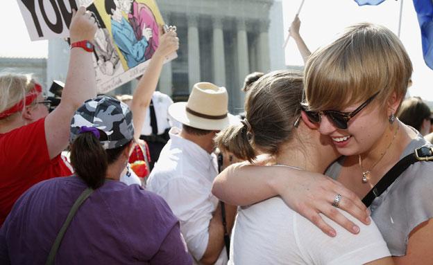 """""""יום היסטורי"""". חוגגים בוושינגטון (צילום: AP)"""
