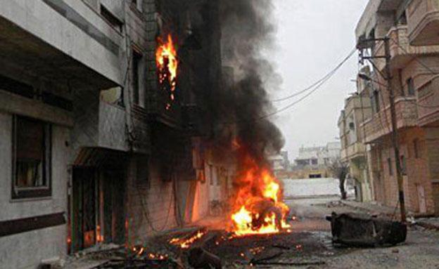 אש ועשן בחומס, סוריה (צילום: חדשות 2)