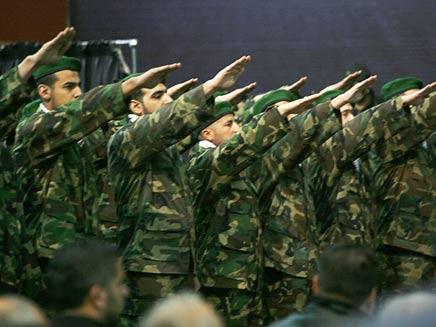 """""""חיזבאללה מאומן ומצויד יותר"""". לוחמים בארגון (צילום: רויטרס)"""