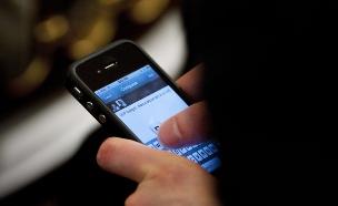 אייפון (צילום: Brendan Smialowski, GettyImages IL)