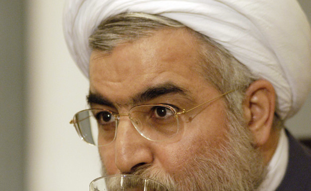 נשיא איראן חסן רוחאני (צילום: Majid, GettyImages IL)