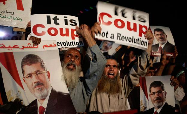 לא מתכוונים להתפנות מרצון. האחים המוסלמי (צילום: AP)