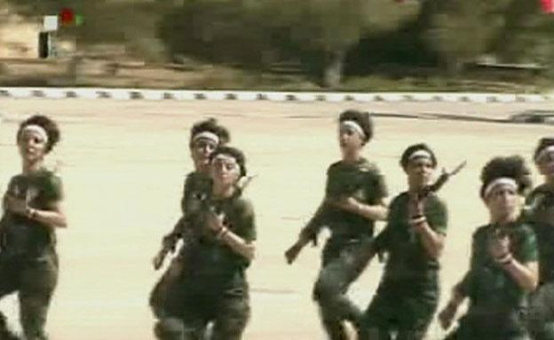 תורמות למורל הלאומי? הלוחמות הסוריות (צילום: טלוויזיה סורית)