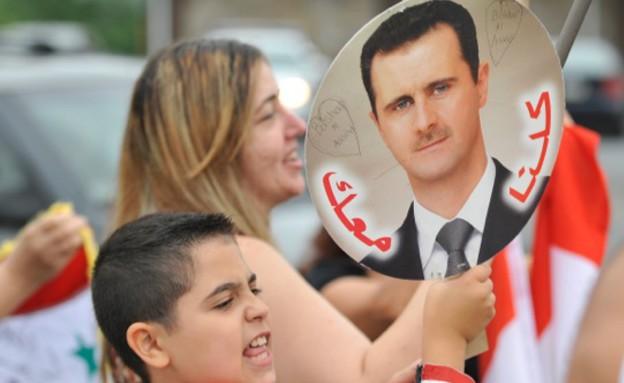 הפגנה נגד תקיפה אמריקנית בסוריה (צילום: Sakchai Lalit | AP)
