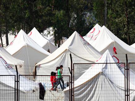 מחנה פליטים סורים בגבול טורקיה (צילום: רויטרס)